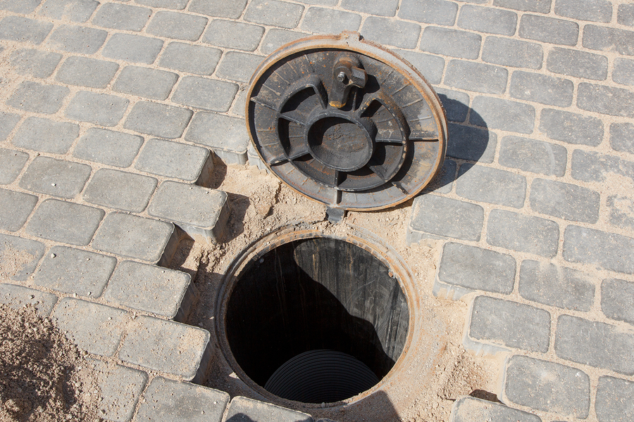 Sewer hole in a brick road